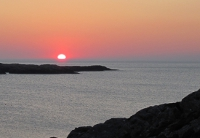 The sun setting into the sea from the North Coast of Inishbofin